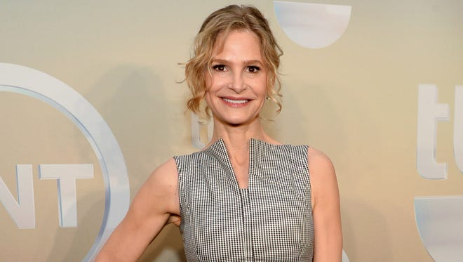 """Kyra Sedgwick poses backstage at the TNT and TBS Network 2014 Upfront Presentations at Madison Square Garden in New York on May 14, 2014. The actress will be starring in John Patrick Shanley new play """"The Danish Widow"""" on the campus of Vassar College this summer."""