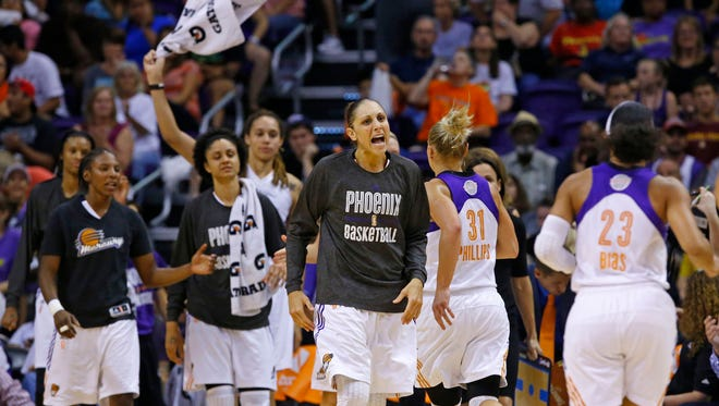 Phoenix Mercury guard Diana Taurasi (3) and teammates react in the closing minuets of their   97-68 win over the Chicago Sky during Game 2 of the WNBA Finals Tuesday, Sept. 98  2014 in Phoenix, Ariz