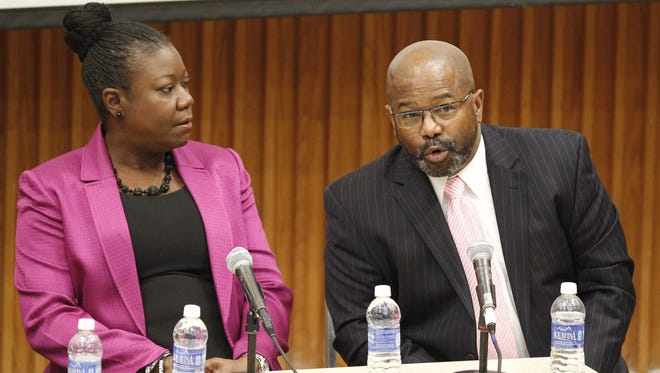 Former RPD Chief James Sheppard, right, address the crowd as Sybrina Fulton, mother of Trayvon Martin, looks on during the University of Rochester's Most Wanted panel discussion at the Hubbell Auditorium Friday evening, March 21, 2014.