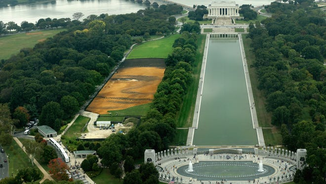 Cuban-American artist Jorge Rodriguez-Gerada's six-acre sand and soil 'facescape' stretches across the the north side of the Reflecting Pool along the National Mall.