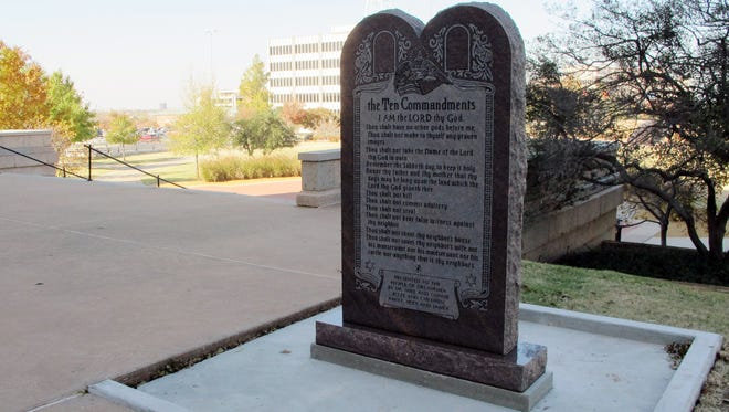 In this Friday, Nov. 16, 2012, file photo, a Ten Commandments monument erected outside the Oklahoma state Capitol is shown in Oklahoma City.