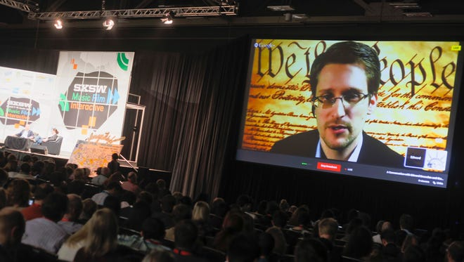 Edward Snowden talks during a simulcast conversation during the SXSW Interactive Festival on Monday.