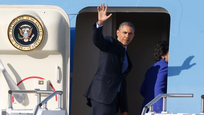 President Obama enters Air Force One on Wednesday.