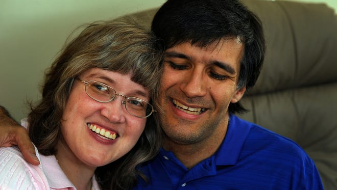 John Blake and Cheryl Coleman, who both have Cerebral Palsy and are to be married this weekend, share a moment with each other at their home in Nashville.