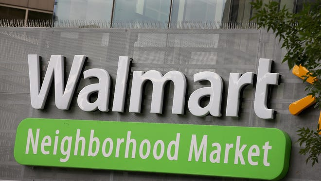 The Walmart logo is displayed above a Walmart Neighborhood Market store on August 15 in Chicago, Illinois.