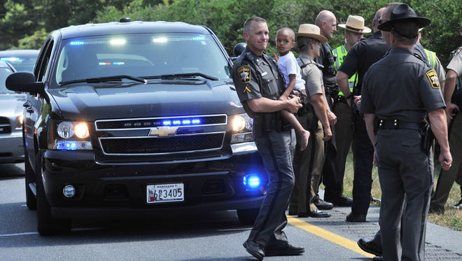 Here, a Wicomico County Deputy holds on to the 4-year-old boy who was in the car.