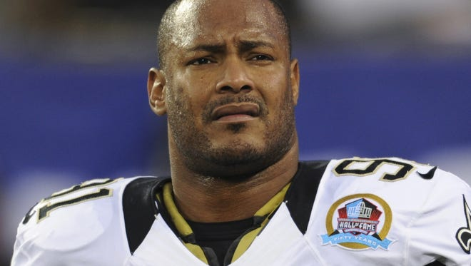 In this Dec. 9, 2012, file photo, New Orleans Saints defensive end Will Smith appears before an NFL football game against the New York Giants in East Rutherford, N.J. Smith was fatally shot after a traffic accident in New Orleans.