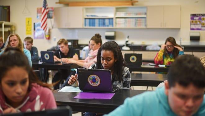 Roosevelt High School freshman Mesha Horsa, 14, works on a worksheet during a biology class Thursday, Jan. 26, 2017, at Roosevelt High School in Sioux Falls.