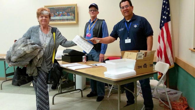 Avid Bingo player Vera Nash purchased her packet during the inaugural  Knights of Columbus Bingo Night held last Thursday at the St. Ann Catholic Church Parish Center, 400 S. Ruby St. The Bingo is hosted by the local St. Michael's Council 15062. Pictured are fellow Knights Richard Feaselman and Andy Gonzales.