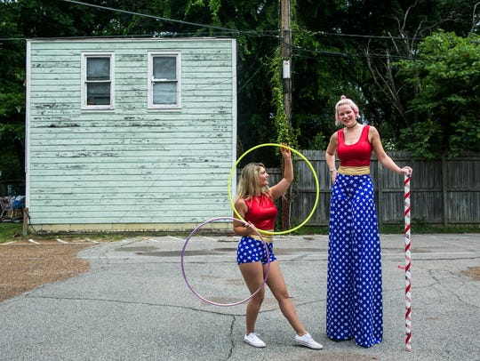 Ellen Phillips, left, looks at Jennie DeCarlo as the ladies represent Co-Motion Studio, a hula hoop studio, at Peabody Elementary School during Cooper Young's Fourth of July parade in 2017.