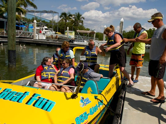 "Passengers get ready to take off in one of the Jet Boat Fun rides on Monday afternoon (03/16/15). The jet boat ""Hot Tuna"" launches out of Salty Sam's Marina in Fort Myers Beach."