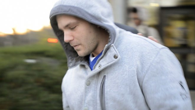 Peter Burnett, 25, of Burlington leaves U.S. District Court in November 2014 after making his initial appearance.