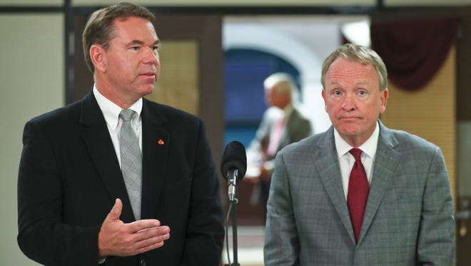 """Interim AD Vince Tyra, standing with interim UofL President Greg Postel, said that """"I don't have a report that there's anything negative tied to the (adidas) contract."""""""
