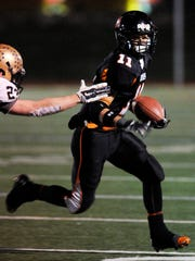 Marlboro High School's Tanner Harshberger runs the ball against Our Lady of Lourdes during the Class B regional final in 2014 .