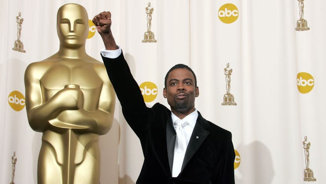 Chris Rock will return to host the Oscars Feb. 28.
