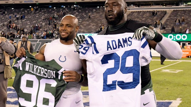 Jets defensive end Muhammad Wilkerson exchanges jerseys with Colts safety and Paterson native Mike Adams after Monday night's loss. (AP Photo/Bill Kostroun)
