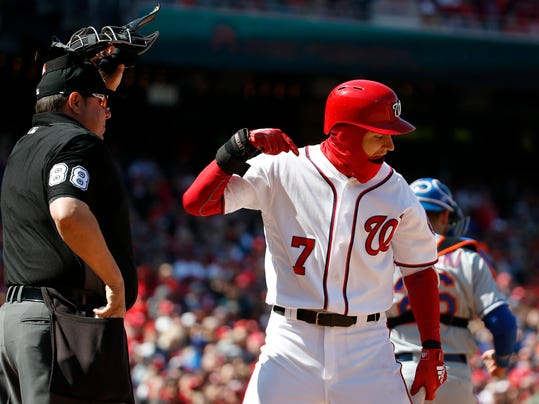 Washington Nationals shortstop Trea Turner (7) argues a called third strike with home plate umpire Doug Eddings (88), and was ejected for it, during the sixth inning of the home opener baseball game against the New York Mets at Nationals Park, Thursday, April 5, 2018, in Washington. (AP Photo/Alex Brandon)