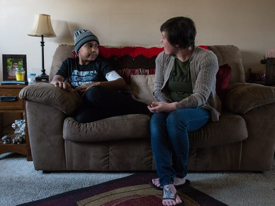 Darius Foreman, 13, of Salisbury, talks to his mother