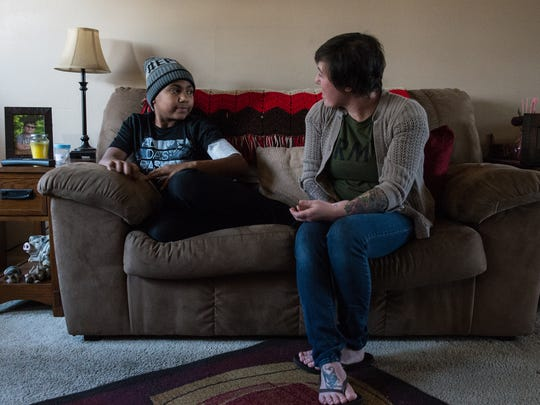 Darius Foreman, 13, of Salisbury, talks to his mother Joy Ellingsworth at their home on Friday, Jan. 26, 2018. Foreman had a screw surgically removed from his skull after falling from a tree.