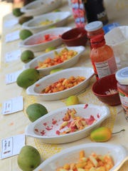Several varieties of chopped mango samples at the Agat Mango Festival on Sunday, June 7.