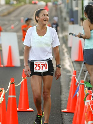 Meara Mccarthy, 26, finished first in the female division of the 5K run during the 7.5K/2.5K Annual Nissan Flag Run held yesterday at Nissan Upper Tumon. Rudy Capistrano/For Pacific Sunday News