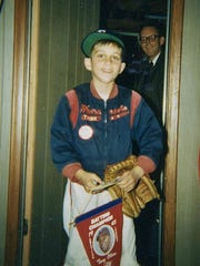 Eight-year-old Phil Bolsta and his father, Kent Bolsta, return home in a good mood after watching the Minnesota Twins beat the Los Angeles Dodgers 5-1 in Game 2 of the World Series on Oct. 7, 1965.