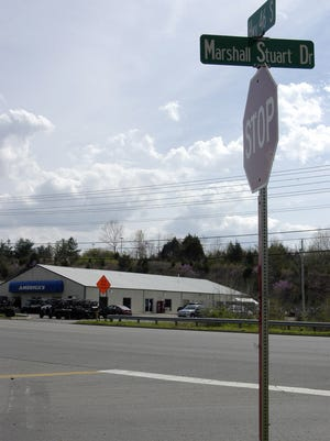 The intersection of Marshall Stuart Drive and Highway 46 with America's Motorsports in the background.