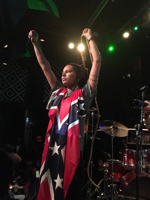 Mississippi native and rapper Gensis Be wrapped herself in a Confederate flag and a noose during a recent show in New York in respsone to recent actions by Miss. Gov. Phil Bryant.