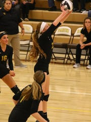 Northmor's Anna Donner sets up a hit during the Division