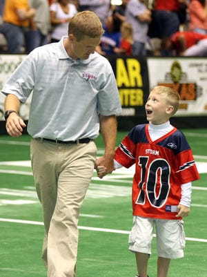 Storm coach Kurtiss Riggs and his son Peyton pictured in 2008.