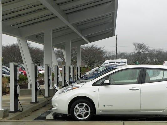 Nissan Leaf cars charging at Smyrna plant.jpg