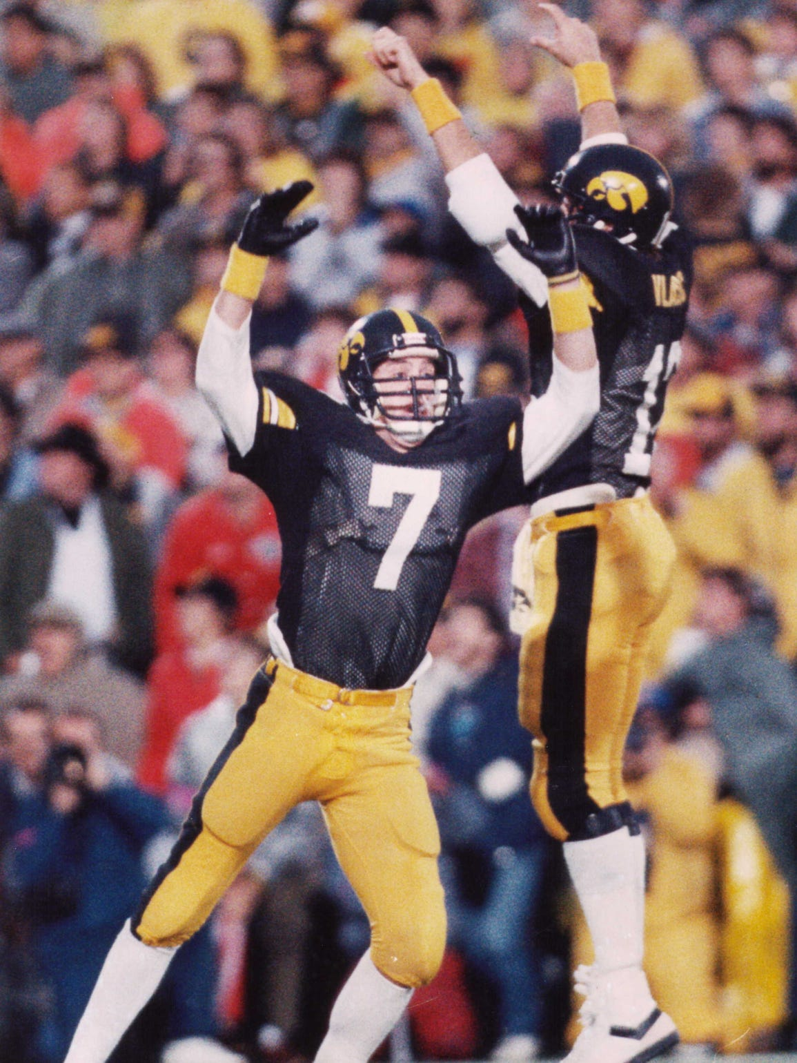 Hawkeyes Rob Houghtlin, left, and Mark Vlasic celebrate