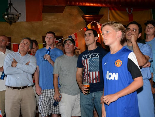 Fans watch as the USA is scored on during Tuesday's World Cup game at Meg O'Malley's in Melbourne, FL.