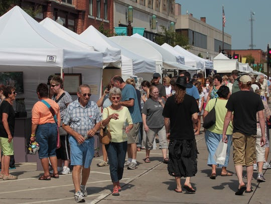 Third Street in downtown Wausu is crowded with art,