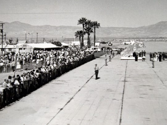 A crowd at Palm Springs Airport in 1962 awaits the arrival of President John F. Kennedy's first visit to Palm Springs. Photo Palm Springs Historical Society