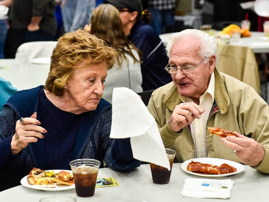 This couple was part of the crowd of more than 400 people who attended the Great Marion Pizza Challenge, sponsored by blues radio station WDIF.