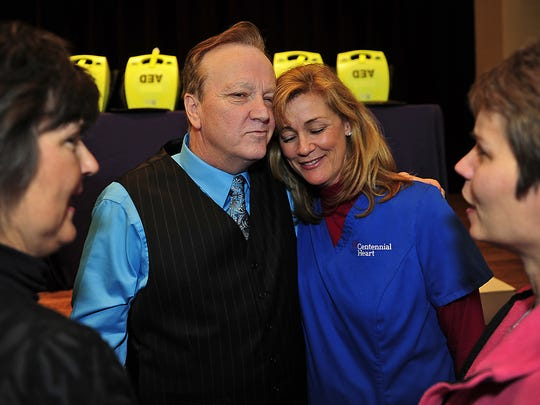 Goodpasture Coach Joey Spann, second from left, hugs nurse Annette Brewer, second from right, with nurses Sharon Crocker, left, and Angel Carter after speaking at David Lipscomb in Nashville, Tenn., Friday, March 25, 2011. These nurses saved him when he had a heart attack during a game.