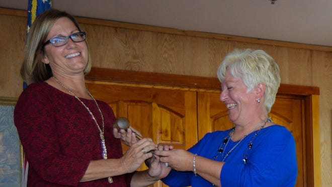 Passing of the gavel to the new board chair.