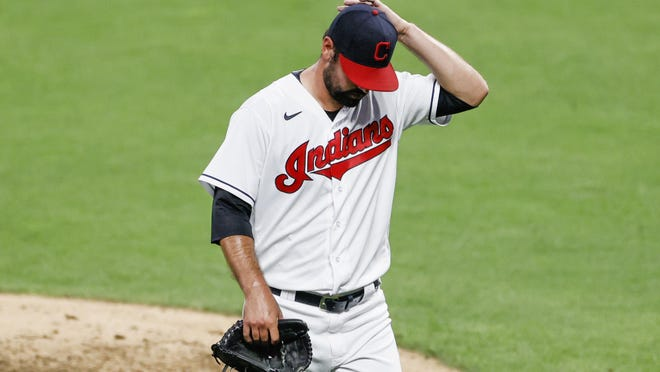 Cleveland Indians starting pitcher Adam Plutko walks off the field after giving up a grand slam to Detroit Tigers' Isaac Paredes and being removed from the game during the fourth inning of a baseball game, Friday, Aug. 21, 2020, in Cleveland.