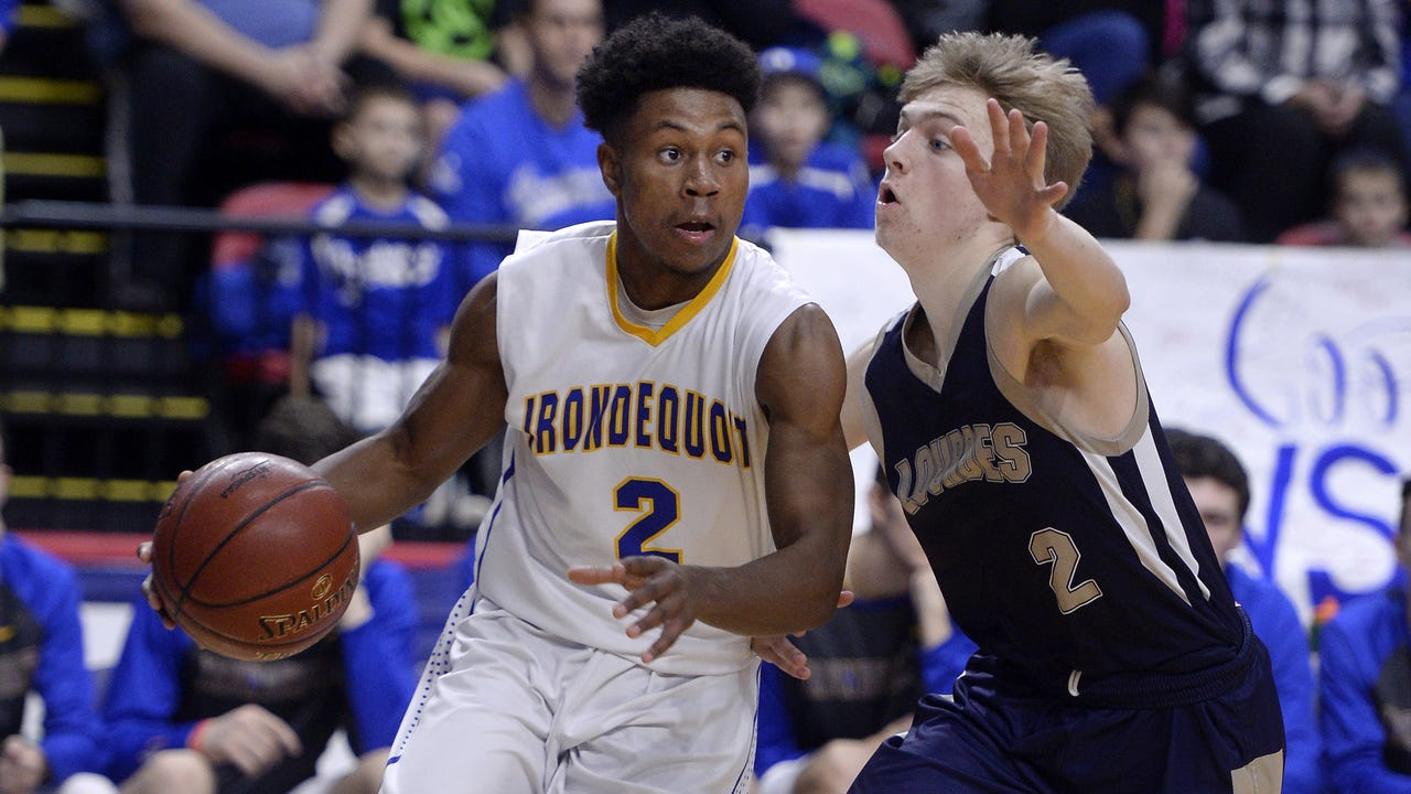 Tysean Sizer scored 21 points as Irondequoit won the Class A state title with a 54-43 victory over Our Lady of Lourdes. (March 19, 2017)