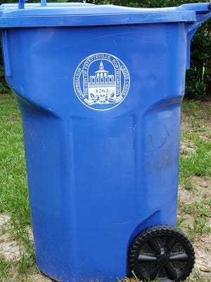 It could cost the city millions of dollars to replace garbage cans with the Market House emblem on them like this recycling can, a staff report says.