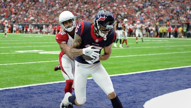 Houston Texans wide receiver Will Fuller (15) makes a catch for a touchdown as Arizona Cardinals cornerback Brandon Williams (26) defends the play during the first half of an NFL preseason football game, Sunday, Aug. 28, 2016, in Houston.