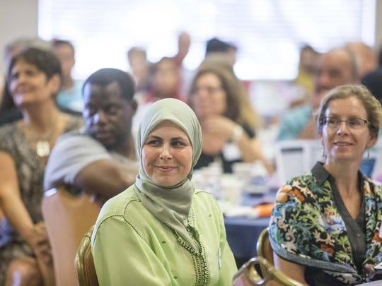 Rheem Kabbani, center, began wearing the headscarf