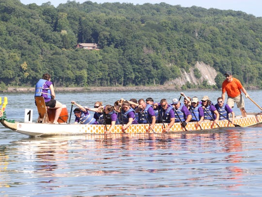 """A dragon boat crewed by team """"Cindy's Inspiration"""""""