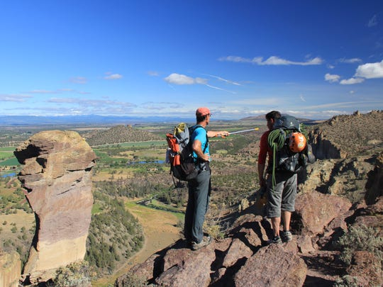 Hikers check out the area they plan to climb at Smith Rock State Park.