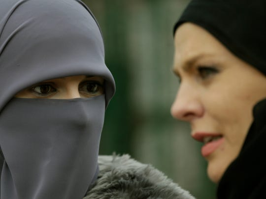 Bosnian Muslim women talk during events to observe World Hijab Day, celebrating the veil traditionally worn by Muslim women, in Sarajevo, Bosnia, on Wednesday, Feb. 1, 2017.  World Hijab Day was initiated in New York in 2013 and has since attracted interest around the world.