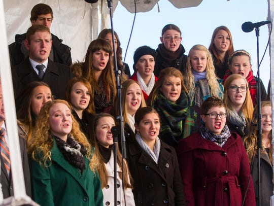 A local choir sings during the dedication ceremony