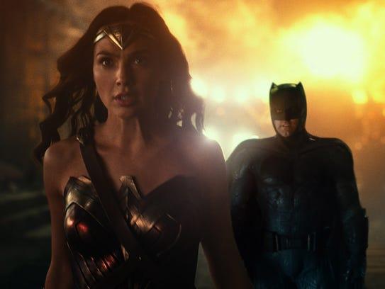 Wonder Woman (left) and Batman (Ben Affleck) lead the