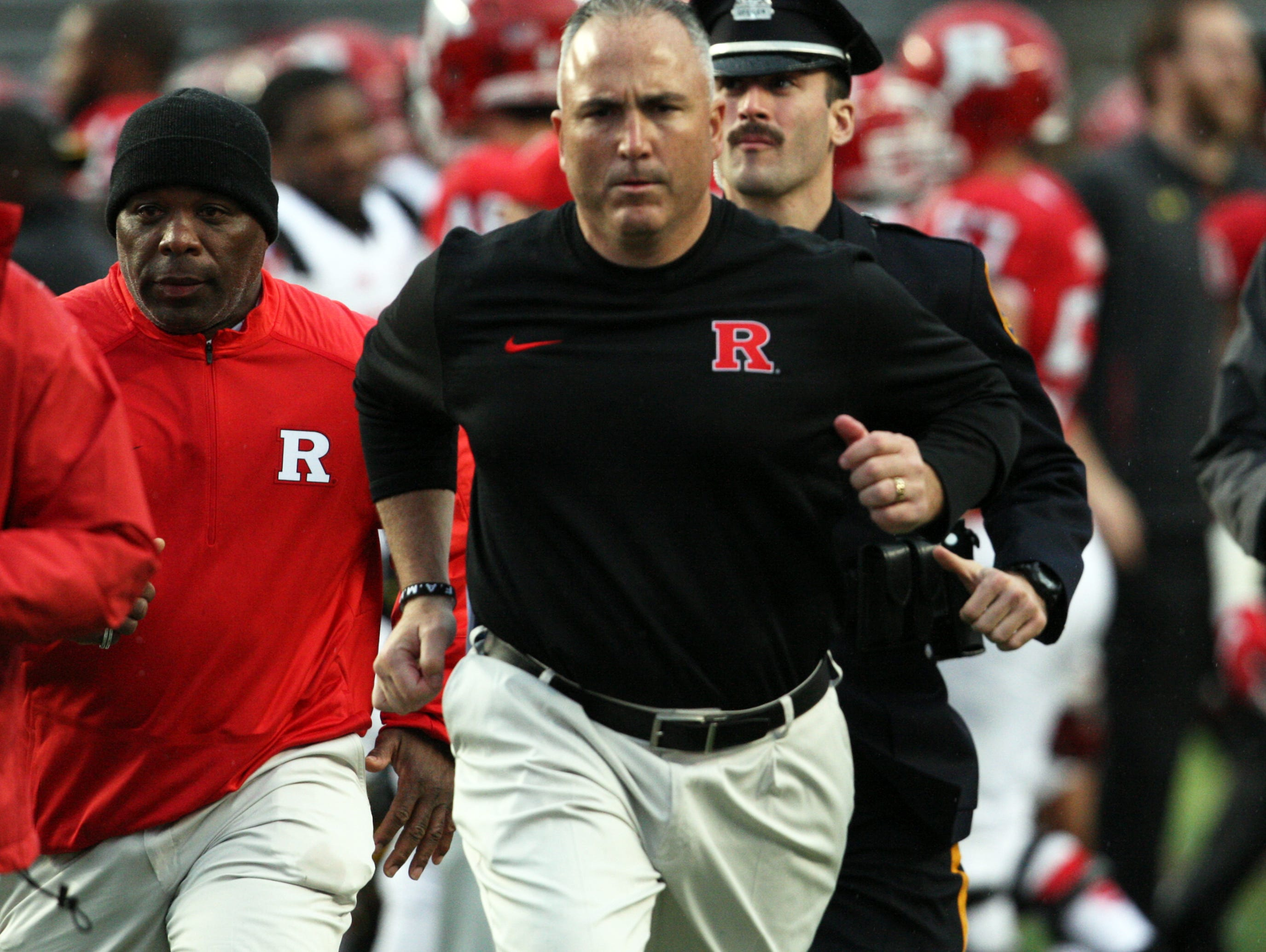 The Rutgers Scarlet Knights take on the Terrapins of the University of Maryland in the season finale of Big Ten football season at High Point Solutions Stadium in Piscataway on Saturday November 28,2015. Rutgers head football coach Kyle Flood runs off the field after his team is defeated by Maryland 41- 46.