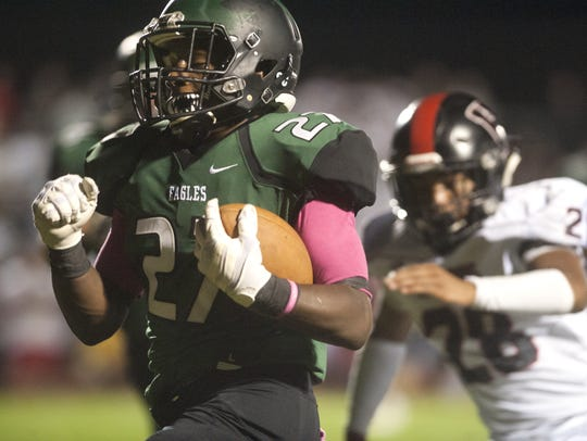 West Deptford's Tyshawn Bookman runs the ball past